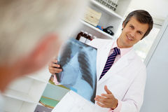 Young male doctor with senior patient Stock Photos