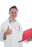 Young male doctor showing thumb up , on white Royalty Free Stock Image