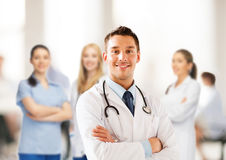Young male doctor with stethoscope. Healthcare and medical concept - young male doctor with stethoscope Royalty Free Stock Image