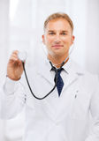 Young male doctor with stethoscope Royalty Free Stock Photos