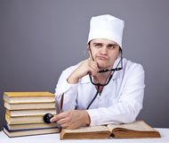 Young male doctor studying medical books Stock Images