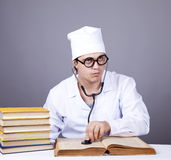 Young male doctor studying medical books Stock Photography