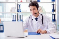 The young male doctor in telehealth concept royalty free stock photography
