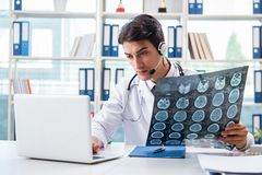 The young male doctor in telehealth concept Stock Photography