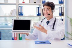 The young male doctor in telehealth concept. Young male doctor in telehealth concept Royalty Free Stock Photography