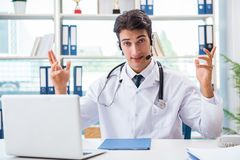 The young male doctor in telehealth concept. Young male doctor in telehealth concept Stock Photos
