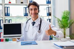 The young male doctor in telehealth concept Stock Image
