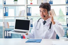 The young male doctor in telehealth concept. Young male doctor in telehealth concept Royalty Free Stock Photo