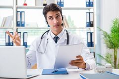 The young male doctor in telehealth concept. Young male doctor in telehealth concept Stock Photo