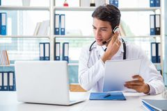 The young male doctor in telehealth concept. Young male doctor in telehealth concept Stock Image