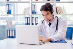 The young male doctor in telehealth concept. Young male doctor in telehealth concept Royalty Free Stock Image
