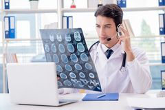 The young male doctor in telehealth concept. Young male doctor in telehealth concept Royalty Free Stock Photos