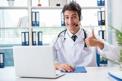 The young male doctor in telehealth concept Stock Photo