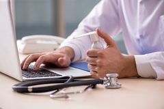 The young male doctor in telemedicine concept. Young male doctor in telemedicine concept stock photography