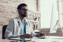 Young Male Doctor Working with Computer in Office. Male Laboratory Researcher Working with Graphs on His Personal Computer. Medicine Concept. Health Concept Royalty Free Stock Photo