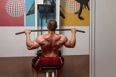 Young Male Doing Back Exercises In The Gym Stock Photography