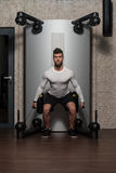 Young Male Doing Back Exercises In The Gym Stock Image