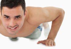 Young male doing push ups Royalty Free Stock Photography