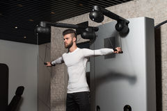 Young Male Doing Shoulder Exercises In The Gym Royalty Free Stock Photography