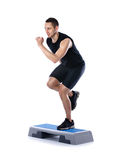 Young male doing step exercise Royalty Free Stock Photos