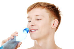 Young male drinking water Royalty Free Stock Photography