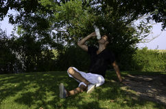 Young male drinking water after workout Royalty Free Stock Photos