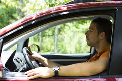 Young male driving a car Stock Photos