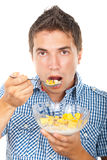 Young male eating cereals royalty free stock photography