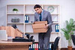 The young male employee being fired from his work. Young male employee being fired from his work royalty free stock photos