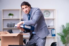 The young male employee being fired from his work royalty free stock photography