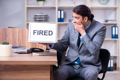 The young male employee being fired from his work royalty free stock image