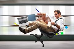 Young male employee is falling. Young male employee falling from the chair royalty free stock photography