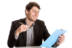 Young male employee during job Royalty Free Stock Photography