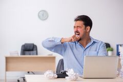 Young male employee rejecting new ideas in the office
