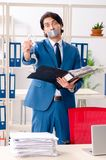 Young male employee with tape on the mouth. The young male employee with tape on the mouth stock images