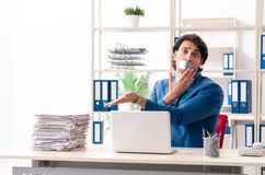 Young male employee with tape on the mouth. The young male employee with tape on the mouth royalty free stock photos