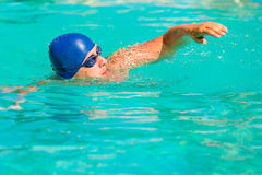 Young male engaged in sports swimming Stock Images