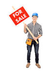 Young male engineer holding a for sale sign Royalty Free Stock Photos