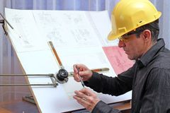 Young Male Engineer - Quality Inspector. The quality dimensional inspector/engineer checking metal components Royalty Free Stock Image