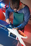 Young Male Engineer or Technician Repair Drone Details. Young Male Engineer or Technician Repair Drone Details Stock Images