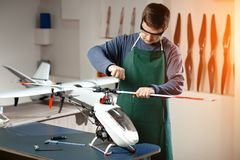 Young Male Engineer or Technician Repair Drone. Young Male Engineer or Technician Repair Drone Stock Images