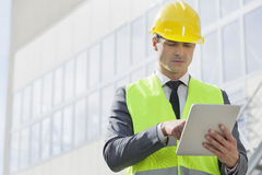 Young male engineer using digital tablet outside industry Stock Photography