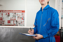 Young male engineer at work in mechanic tools storage room Royalty Free Stock Photography