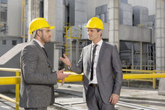 Young male engineers discussing at construction site Stock Photography