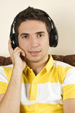 Young male enjoy the music royalty free stock photography