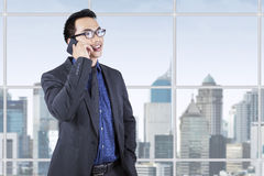 Young male entrepreneur talking on cellphone Stock Images