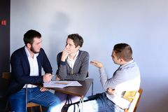 Young male entrepreneurs and partners are engaged in solving bus royalty free stock photography