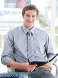 Young male executive looking at his agenda Royalty Free Stock Photo