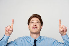 Young male executive pointing up Stock Photo
