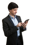 Young male executive using digital tablet Stock Photo